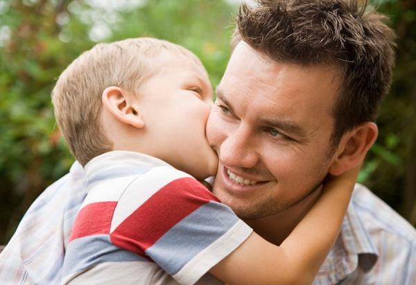 Little boy kissing daddy